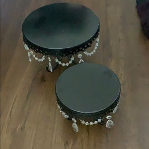 2 black cake stands